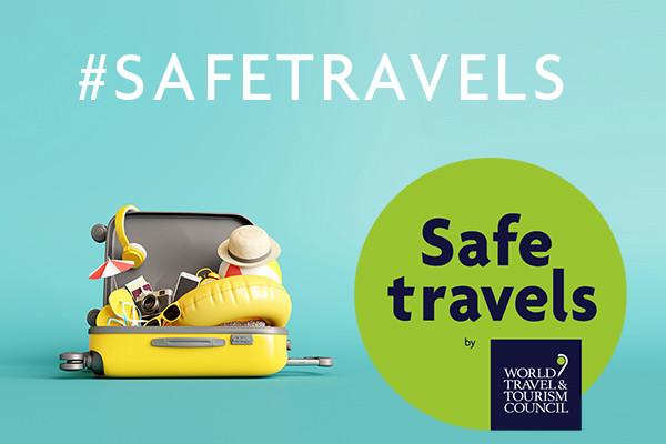Label SAFE TRAVEL et valise symbolisant le voyage
