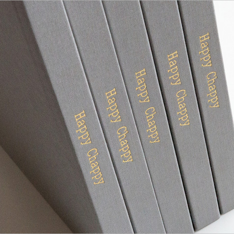 STAMPED SPINE:  A custom die is created for a stamp for a title to personalize the spine of your book. Choose gold foil, silver foil, rose gold foil or blind deboss for an elegant result.