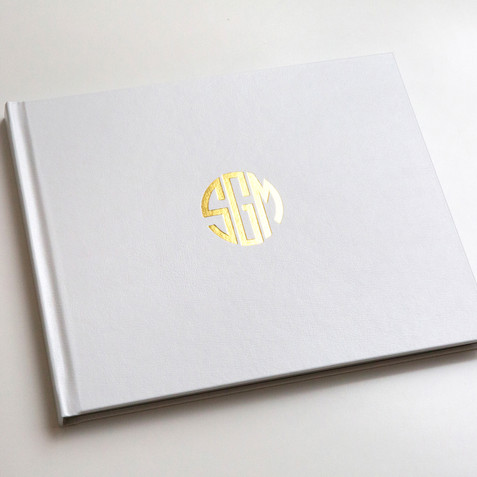 white leather and gold foil of custom designed monogram.