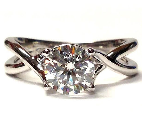 Twist Solitaire & Peek-A-Boo Diamond Engagement Ring Mounting