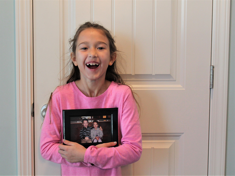 Bailey holding the photo of her and Brevin