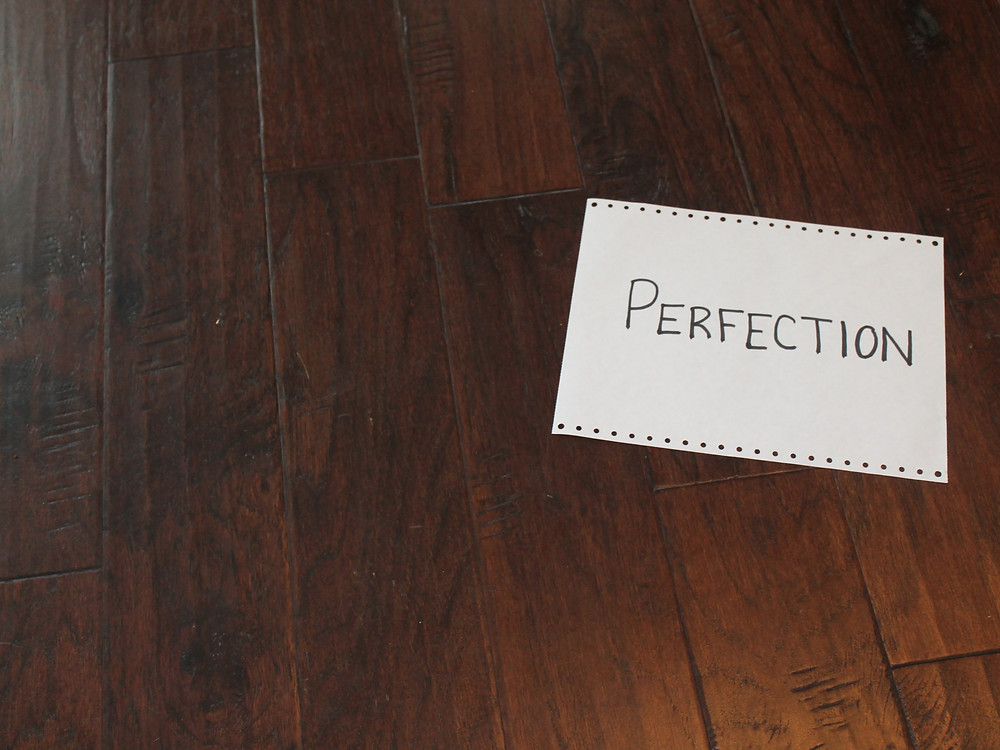 Perfection on a piece of paper on the floor