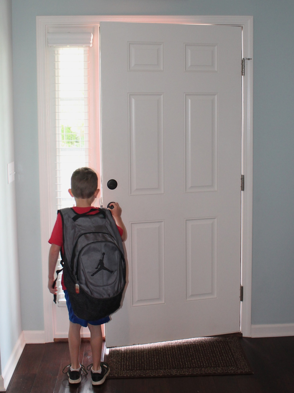 Ethan walking out the door for school