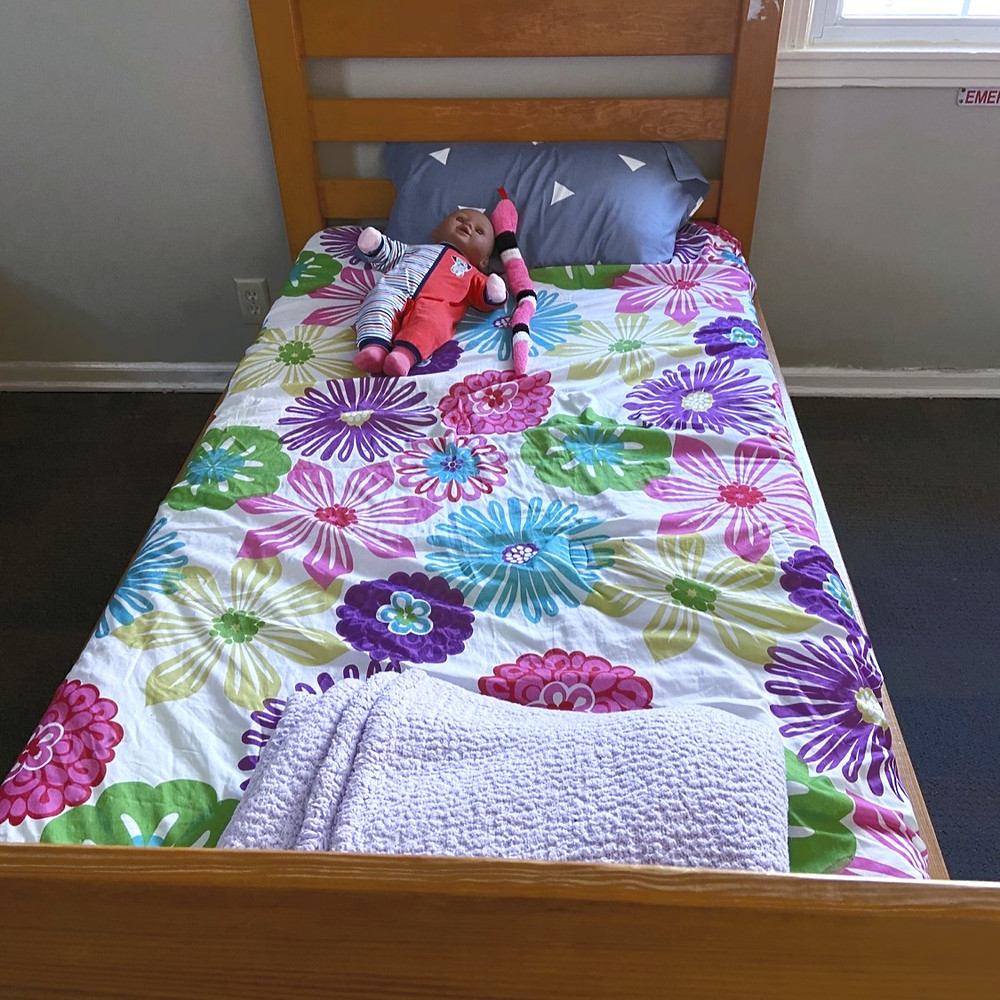 A teenage girls bed at the group home.