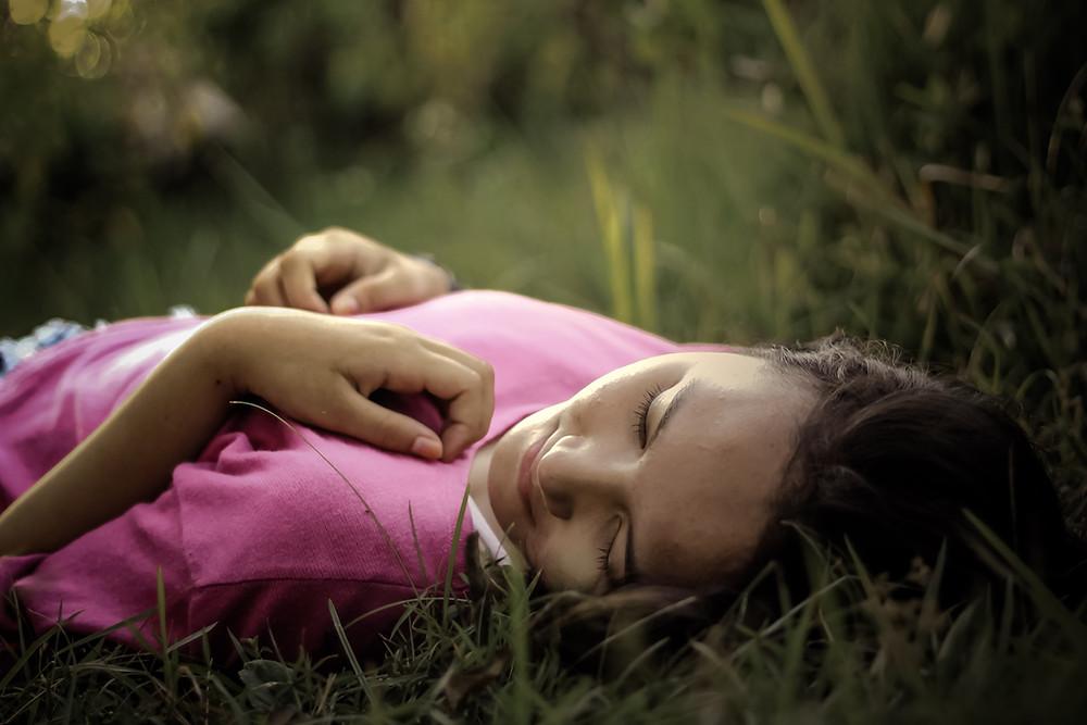girl lying down in grass