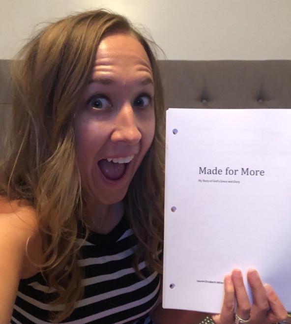 Lauren holding final book manuscript