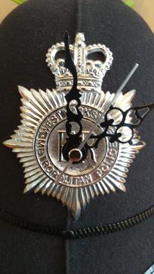 Badged helmet clock.