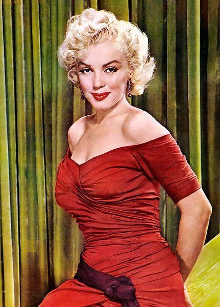 Marilyn Monroe wearing a red dress in 1952