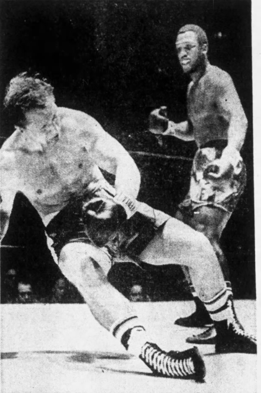 Using his deadly left hook, Joe Frazier sends Dave Zyglewicz to the canvas.