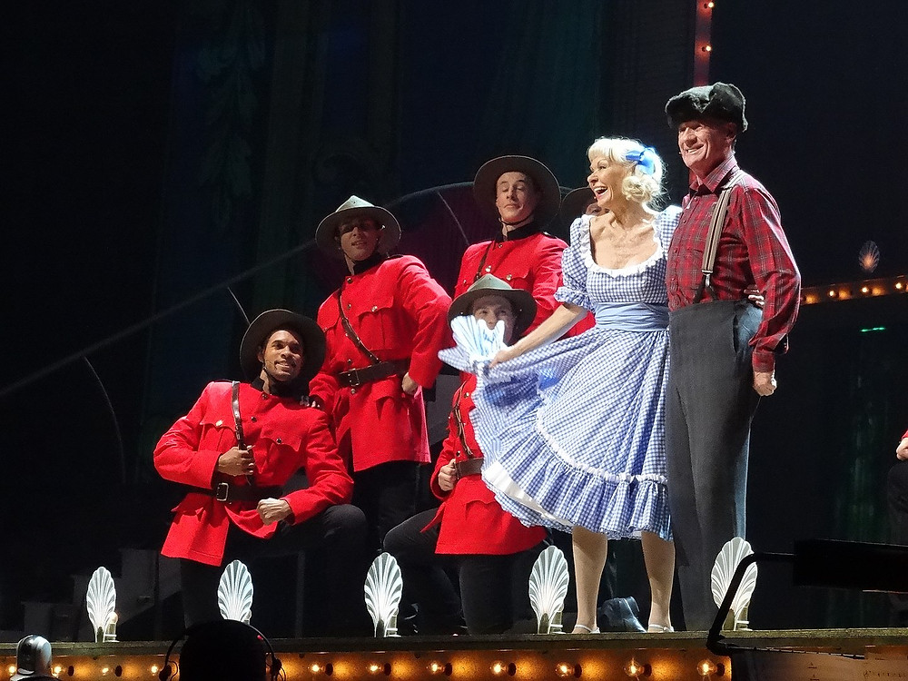 "Carol Cleveland and Michael Palin perform ""The Lumberjack Song"" as part of Monty Python Live (Mostly) in July 2014"