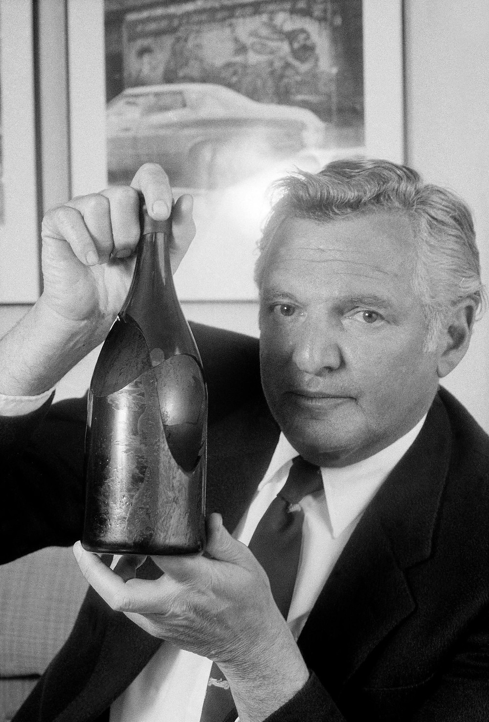 William Sokolin holding the bottle broken at the Four Seasons in 1989. It was insured.Credit...