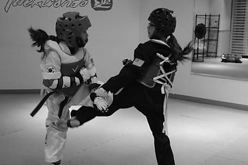 kids sparring in martial arts class