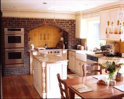 Red-Brick-Kitchen-White-Cabinets