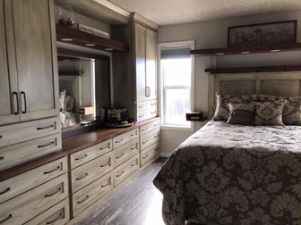 Custom built-in cabinets and bed with distressed finish