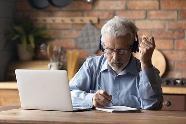 older man studying.jpg
