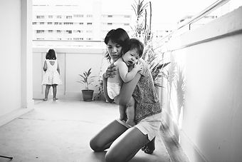 Shumei, connection, hugging, holding, parents, caregiving, caegiver, children, baby