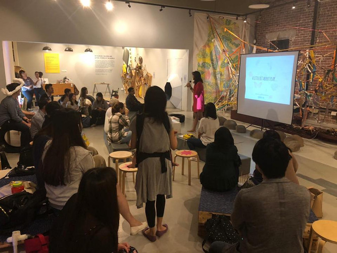 Shumei Giving a talk.jpg
