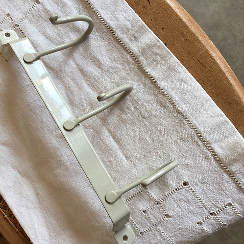 Pretty set of three enamel coated metal coat hooks in a porcelain colour way, shabby chic styling at Source for the Goose