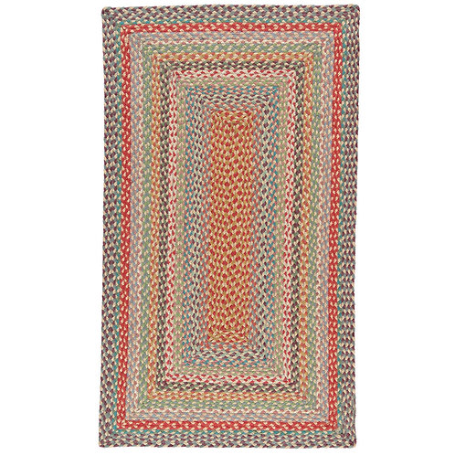 Organic jute rectangle braided rug in bright Carnival, The Braided Rug Company interiors at Source for the Goose, Devon