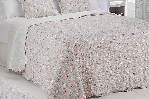 Delicate rose print on light grey quilted bedspread, Isla Quilt at Source for the Goose, devon