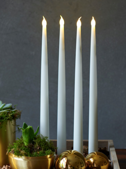 Tall white tapered LED candles, romantic interiors at Source for the Goose, South Molton, Devon