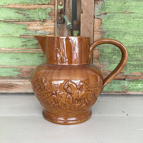 Glazed brown French jug with depiction of farm life, to buy from Source for the Goose