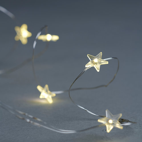 Warm white star shaped string of LEDs on silver wire, Christmas at Source for the Goose, South Molton, Devon