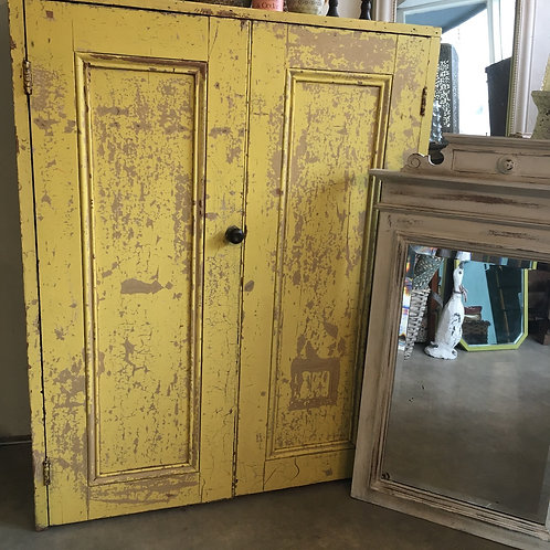 Chippy yellow painted cupboard with two doors and shelving, secondhand furniture at Source for the Goose, Devon