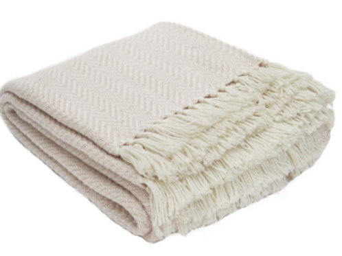 Weaver Green shell pink herringbone blanket made from recycled plastic bottles, interiors at Source for the Goose