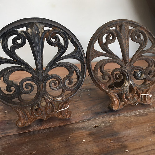Two vintage french hearth pot holders, showing rusty shabby chic charm.