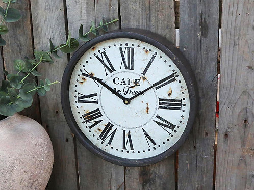 Black slightly distressed metal framed clock with roman numerals, french style interiors at Source for the Goose