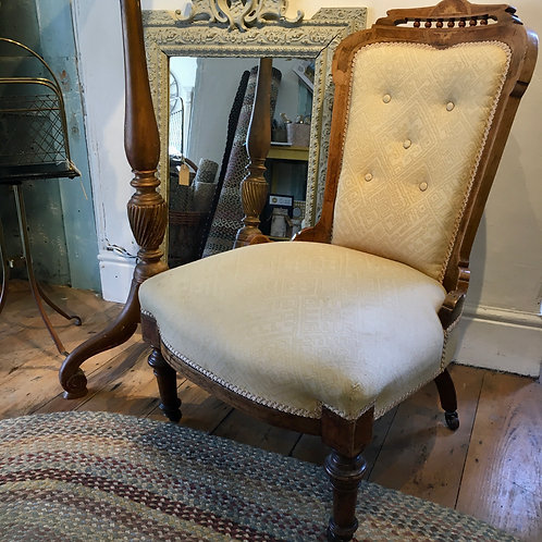 French nursing chair with walnut frame and pale cream fabric at Source for the Goose