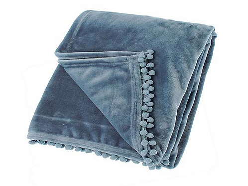 Soft cashmere touch throw  with pom poms in smoke blue, interiors at Source for the Goose