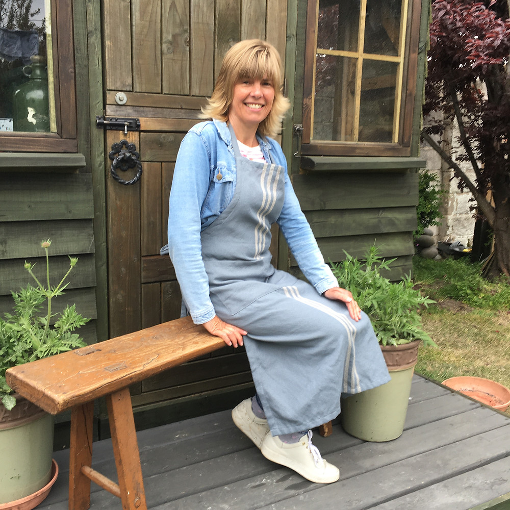 Jill, owner at Source for the Goose modelling Weaver Green Apron made from Recycled Plastic Bottles, available to buy