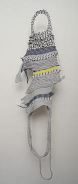 Remanente textil, descarte de orillo.  Costura y terminaciones hechas a mano.   150x48x5cm