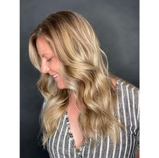 Added dimension & toned her down to a more sandy color by Taeylor at Vibe Salon.