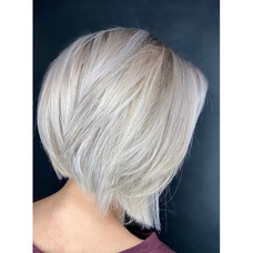 Short, icey blonde, & edgy by Taeylor at Vibe Salon.