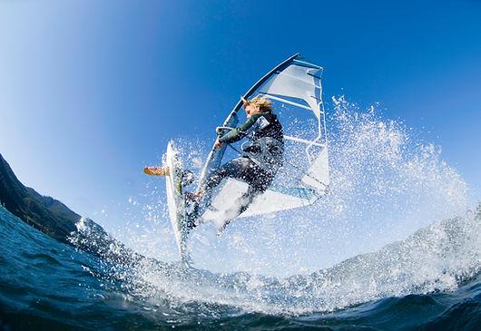 Man windsurfing in the ocean