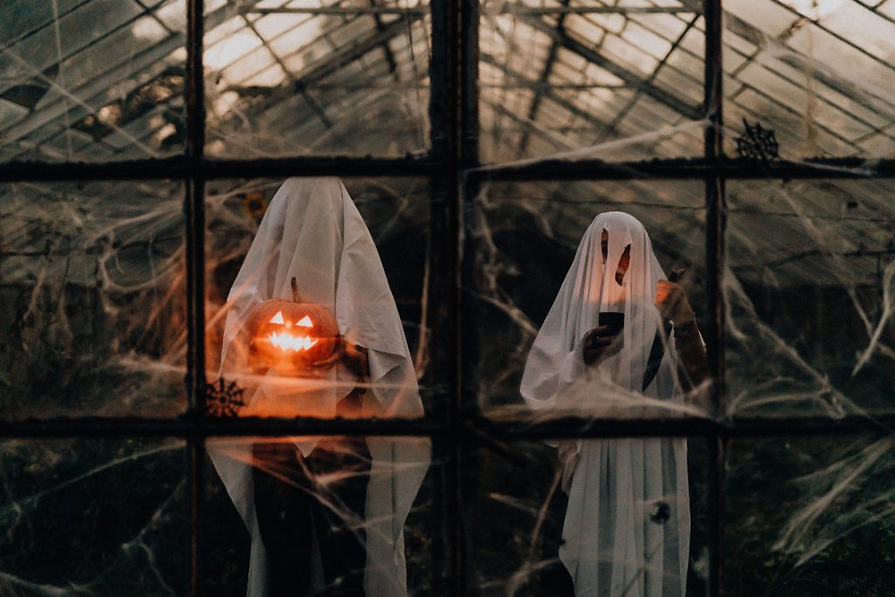 Trick-or-treating in ghost costumes like these is still possible this Halloween.
