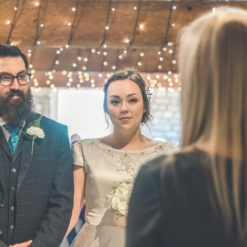 Wedding couple making their vows