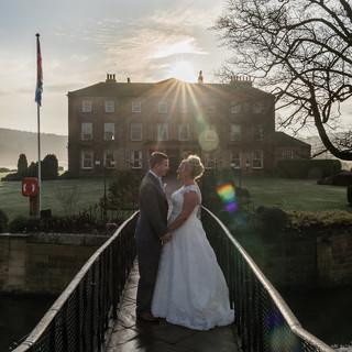 Wedding photo taken on the bridge at waterton park wakefield