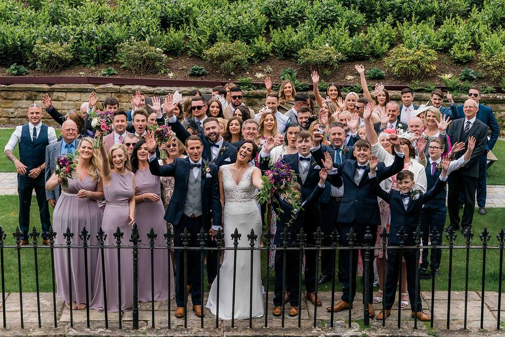 Group photograph in the garden at Raithwaite Hall Wedding