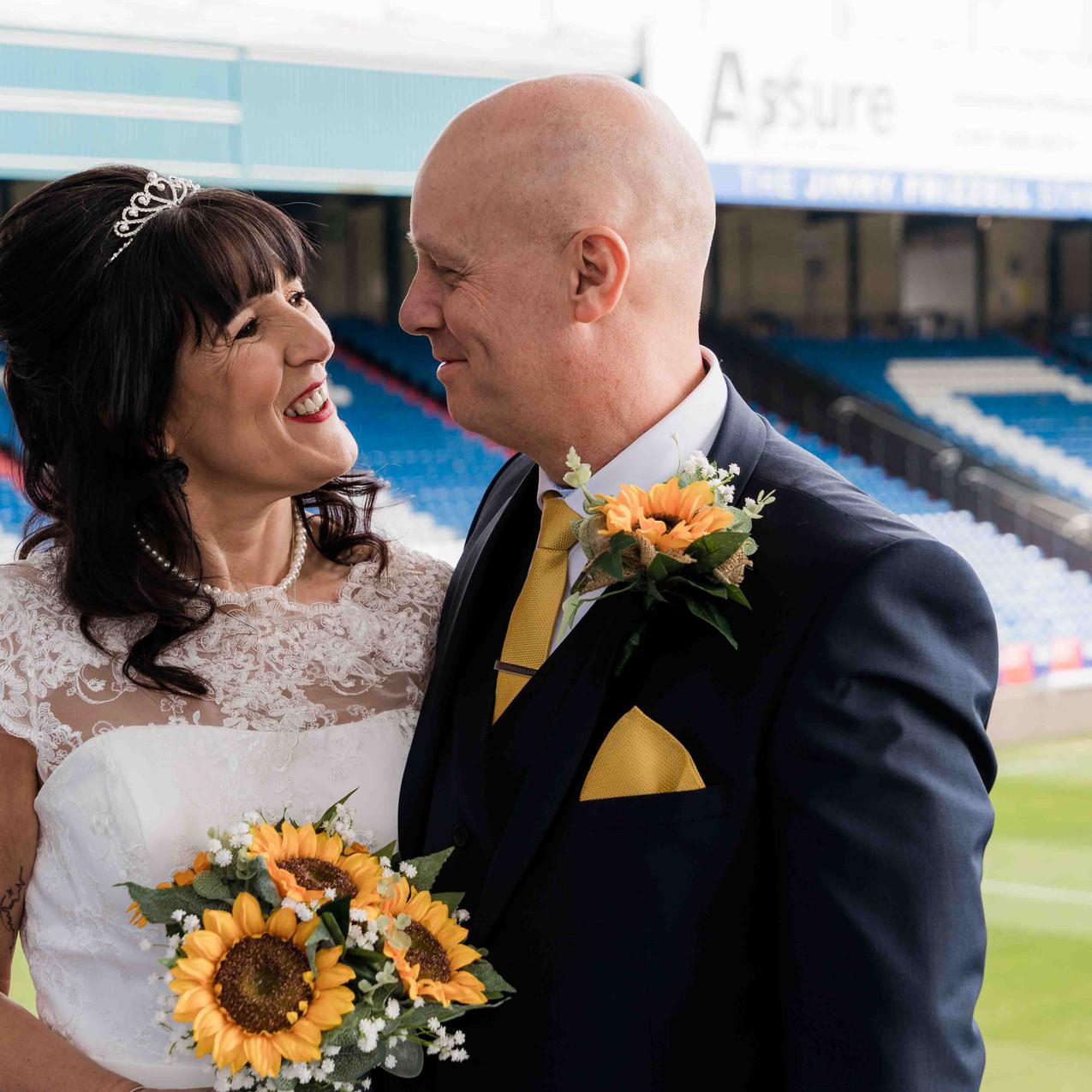 Football pitch wedding photo