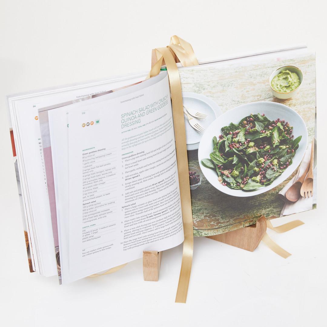 Bookshelf with Dani Valent cookbook open