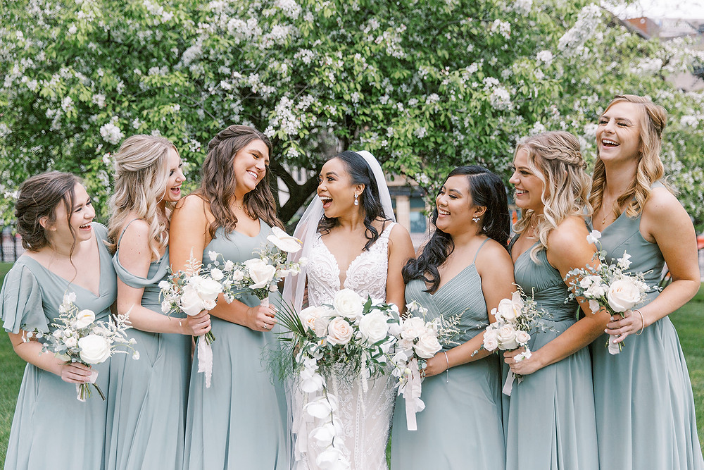 """""""The Perks of Having a Large Wedding Party :  Contemplating a small wedding party versus a larger one? If you're going to go all out for your wedding, you might as well do the same when choosing your bridesmaids and groomsmen, right? To help seal the deal, we've compiled a few of the many perks that come along with having a large wedding party, plus how they can help make your special day become the best day ever.  NONTRADITIONAL WEDDING PARTY IDEAS  Less Work for the Maid of Honor  As a maid (or matron) of honor, you're tasked with planning several extra festivities for the bride. With multiple bridesmaids, each of them can help take some of those responsibilities. Ask a few bridesmaids to help plan your bachelorette party while asking another couple to tackle the bridal shower. Your MOH will thank you later. There are no hurt feelings when everyone is included and able to help.  ADVERTISING  More Groomsmen and Bridesmaids = More Availability  If there's a lot of set-up to be done before the wedding day, any extra hands can help. Having extra groomsmen and bridesmaids can help with all those extra tasks to prepare for the rehearsal, ceremony, or reception. Allow others to help-being sane is better than being in control.  Beautiful Pictures  More bridesmaids means more bouquets, and more flowers means jaw-dropping photos (in our personal opinion)! You also have more room to play with the bridesmaids' dresses. With every girl in a different colored dress that matches with a theme, your pictures will have their own unique style!  All of Your Friends, Together  Let's be real: Having all of your friends in your wedding party means you're having fun with all of your closest people at the same time. Think about having all of your closest girlfriends in your bridal suite with you. There won't be any time for pre-wedding jitters when you're celebrating with your dearest friends. What could be better than that?""""  Martha Stewart says it best!"""