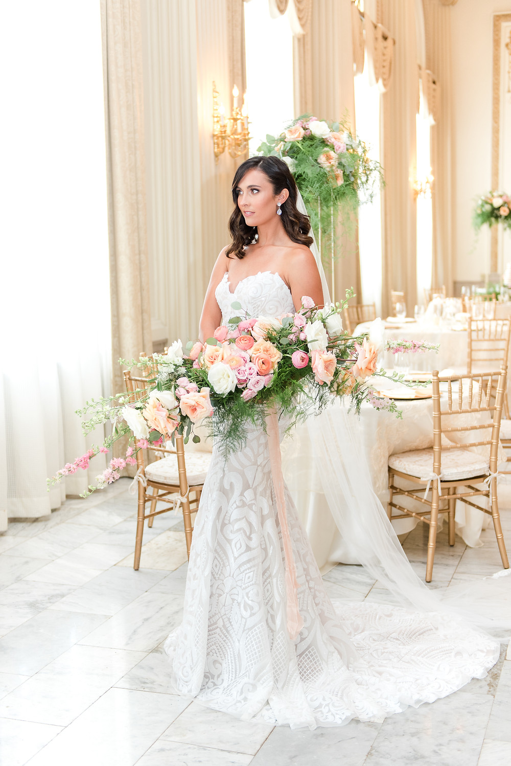 """Blush by Hayley Paige Bridal Gowns are a go-to for luxury brides!  """"Blush by Hayley Paige bridal gown - Ivory Marrakesh all-over beaded gown, scalloped deep sweetheart neckline with nude net insert and t-strap back, full A- line skirt and cashmere lining"""" is so descriptive and explains the gown to a T!  """"Hayley Paige, head designer of the Blush and Hayley Paige bridal collections, made a jump start in fashion by interning for Nina Garcia at Elle magazine while attending Cornell University. She went on to work in ready-to-wear for Jill Stuart after receiving honorary attention for her 10-piece bridal collection shown during her graduating year. Eventually, her dedication to all things creative led to designing and styling abroad where she developed an appreciation for European influences. Paige established herself as an integral designer for the Melissa Sweet bridal and bridesmaid collections and was the primary designer behind the first Marchesa Eterna bridal collection at Priscilla of Boston. Her contributions can be found in highly sought-after bridal publications, as well as nation-wide bridal boutiques. Ever so eclectic, her designs capture a romantic and charming aesthetic that balances inner ingénue and sophistication. Her interpretation of worldly influences and desire to dress hopeful romantics, have provided a foundation for a fanciful and fresh take on bridal wear. Never taking herself too seriously and fully embracing the adorning history of the bridal industry, Hayley Paige develops her craft from an inspirational place of appreciation and enjoyment."""""""