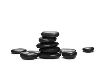 Pile black rocks isolated on white backg