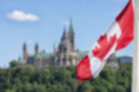 Canadian-flag-Parliament-Buildings.jpg