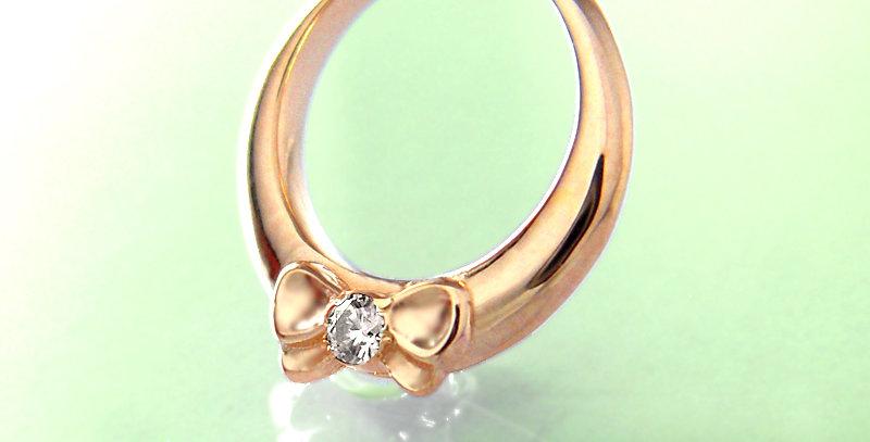 リボンのベビーリング<ペンダントタイプ> 4月誕生石ダイヤモンド K10PG(10金ピンクゴールド)