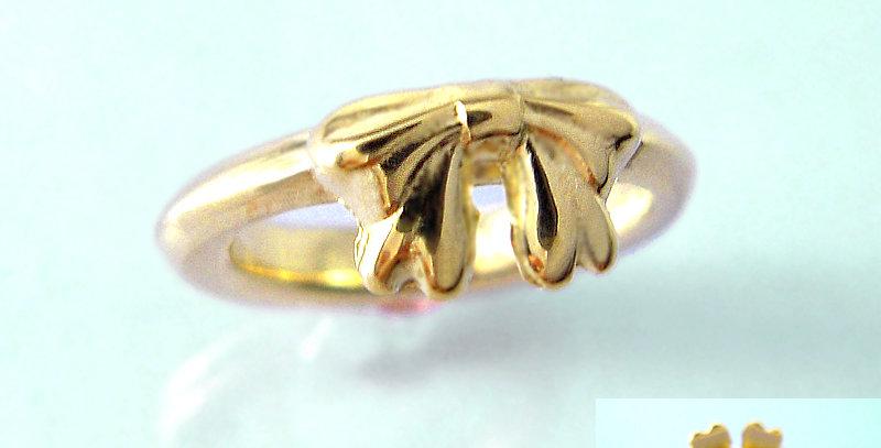 リボンのベビーリングC 4月誕生石ダイヤモンド K10YG(10金イエローゴールド)